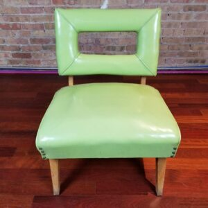 Pictured, Lime Green Vinyl Window-Back Low Chair, among the vintage rental furniture from Catalyst Ranch