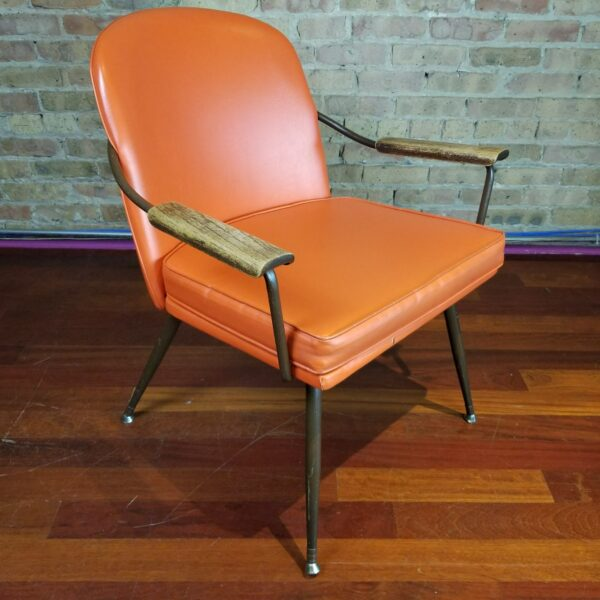 Pictured, Butterscotch Vinyl Armchair with Reversible Tweed-Stripe Seat, among the vintage rental furniture from Catalyst Ranch
