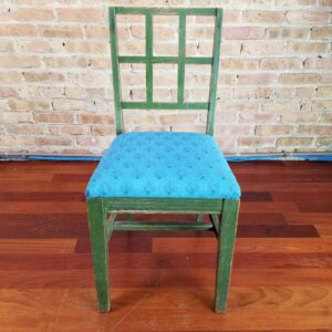 Pictured, window-back dining chair with blue seats, among the vintage rental furniture from Catalyst Ranch
