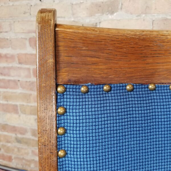 Pictured, close up of blue studded fabric on wood dining chair, among the vintage rental furniture from Catalyst Ranch