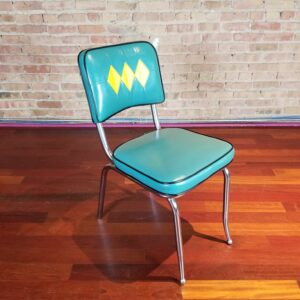 Pictured, Jade and yellow diamond vinyl dining chair, among the vintage rental furniture from Catalyst Ranch