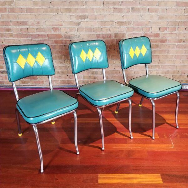 Pictured, trio of Jade and yellow diamond vinyl dining chairs, among the vintage rental furniture from Catalyst Ranch