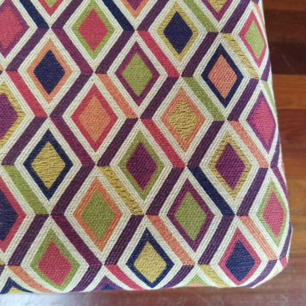 Pictured, Close Up of multi-colored Diamond Pattern Wooden Dining Chair Seat (orange, yellow, pink, purple, green, orange, white), one of a set of four to be rented in pairs, among the vintage rental furniture available from Catalyst Ranch