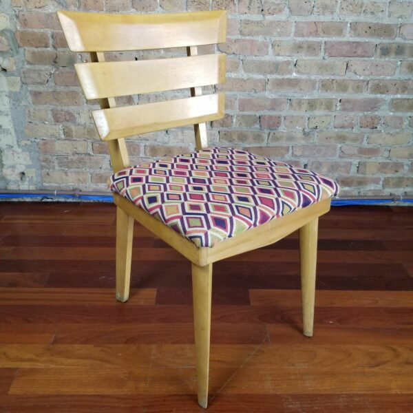 Pictured, Diamond Pattern Wooden Dining Chair, one of a set of four to be rented in pairs, among the vintage rental furniture available from Catalyst Ranch