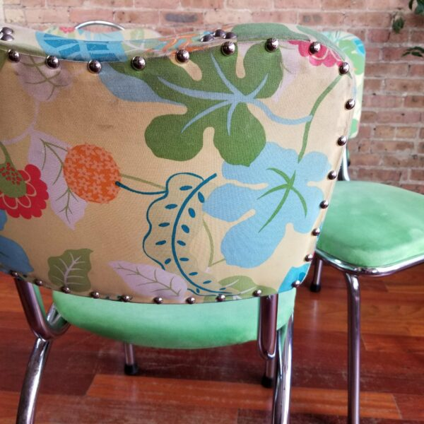 Pictured, close up of garden flora pattern on dining chair, among the vintage rental furniture from Catalyst Ranch