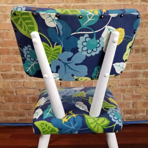 Pictured, Rear view of Blue Exotic Leaves Dining Chair with white wood legs and frame, one of a set of four to be rented in pairs, among the vintage rental furniture available from Catalyst Ranch