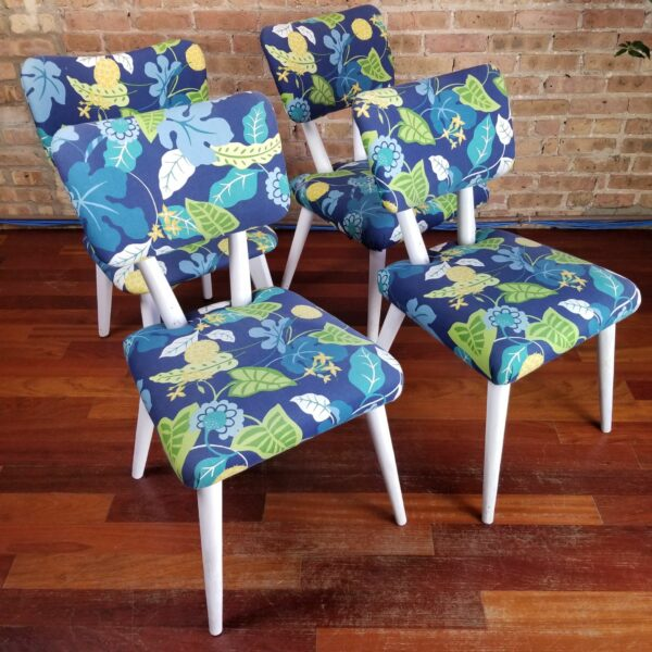 Pictured, Set of four Blue Exotic Leaves Dining Chairs with white wood legs and frames, to be rented in pairs, among the vintage rental furniture available from Catalyst Ranch