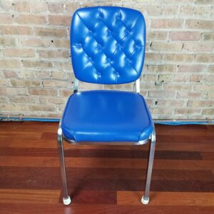 Pictured, Blue Tuft Dining Chair, one of a set of four to be rented in pairs, among the vintage rental furniture available from Catalyst Ranch