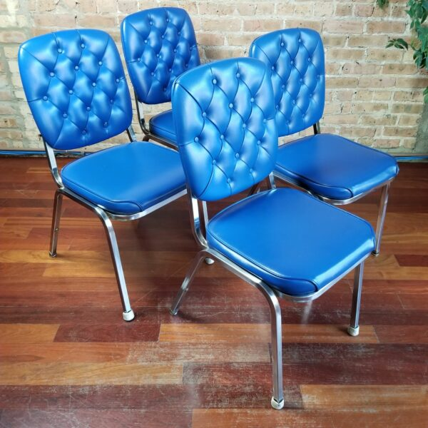 Pictured, Set of four Blue Tuft Dining Chair, to be rented in pairs, among the vintage rental furniture available from Catalyst Ranch