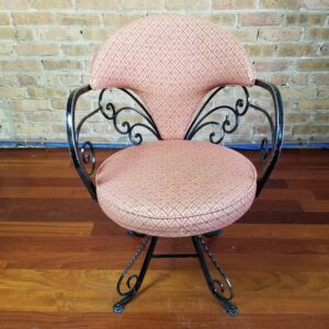 Pictured, Curled Iron Swivel Dining Chair with brown patterned cushions, one of a set of four to be rented in pairs, among the vintage rental furniture available from Catalyst Ranch