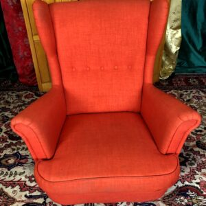Pictured, Red Tweed high back comfy arm chair, among the vintage rental furniture from Catalyst Ranch