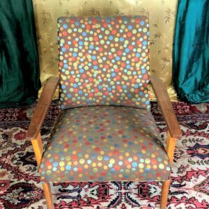 Pictured, Colorful Gumball pattern on dark Fabric Armchair, among the vintage rental furniture available from Catalyst Ranch