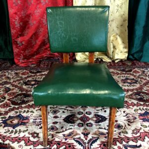 Pictured, Pine Green Vinyl Low Armchair, among the vintage rental furniture from Catalyst Ranch