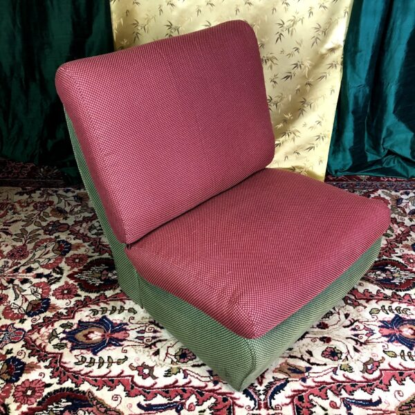 Pictured, green base, red seat, color block plush cushion low chair, rented as a set, among the vintage rental furniture available from Catalyst Ranch