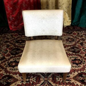 Pictured, White Textured Vinyl Low Chair, among the vintage rental furniture available from Catalyst Ranch