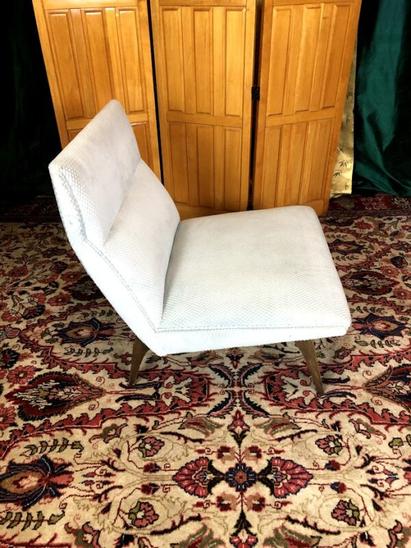 Pictured, Side-view of White Fabric Angular Low Chair (one of a pair), among the vintage rental furniture available from Catalyst Ranch