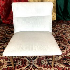 Pictured, White Fabric Angular Low Chair (one of a pair), among the vintage rental furniture available from Catalyst Ranch