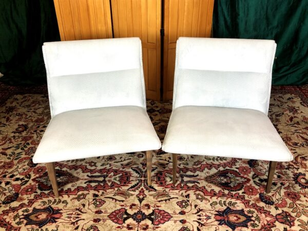 Pictured, Pair of White Fabric Angular Low Chair, among the vintage rental furniture available from Catalyst Ranch