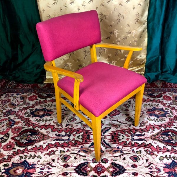 Pictured, Yellow-Washed Wood Armchair with Magenta Upholstery, among the vintage rental furniture from Catalyst Ranch