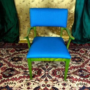 Pictured, Green-Washed Wood Armchair with Cerulean Blue Upholstery, among the vintage rental furniture from Catalyst Ranch