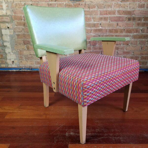 Pictured, Lime Vinyl and Tangy Triangle Fabric Armchair. Tangy triangle fabric in orange, green, blue, yellow and pink, among the vintage rental furniture from Catalyst Ranch