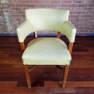 Pictured, Chartreuse Green Vinyl Studded Armchair, among the vintage rental furniture from Catalyst Ranch