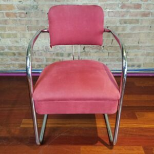 Pictured, Light Red Fabric and Chrome Armchair, among the vintage rental furniture from Catalyst Ranch