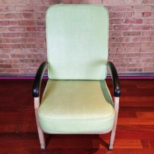Pictured, Light Sage Green Vinyl, High Back Armchair, among the vintage rental furniture from Catalyst Ranch