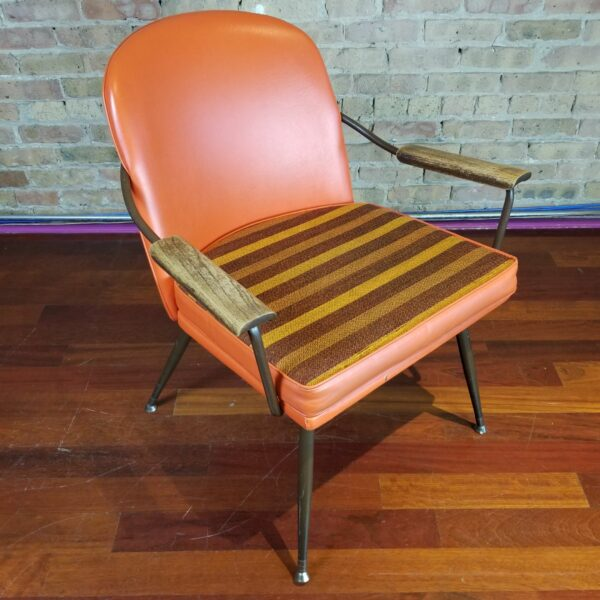Pictured, Butterscotch Vinyl Armchair with Reversible Tweed-Stripe Seat, among the vintage rental furniture available from Catalyst Ranch