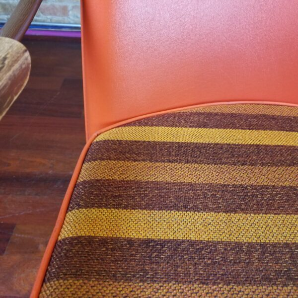 Pictured, Close up of brown and yellow tweed-stripe pattern on Butterscotch Vinyl Armchair with Reversible Seat, among the vintage rental furniture available from Catalyst Ranch
