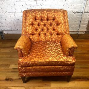 Pictured, Golden Orange Marmalade Brocade Comfy Armchair. One of two, among the vintage rental furniture from Catalyst Ranch