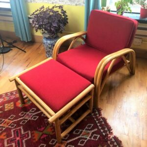 Pictured, Bamboo Armchair and Ottoman with Cranberry Fabric Cushions, among the vintage rental furniture from Catalyst Ranch