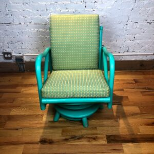 Pictured, Turquoise and Lime Swivel Armchair, among the vintage rental furniture from Catalyst Ranch