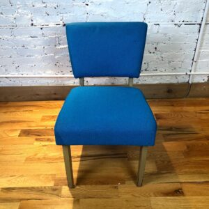Pictured, Cornflower Blue Woven Fabric Low Chair, among the vintage rental furniture from Catalyst Ranch
