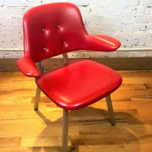 Pictured, Candy Red Vinyl Armchair, among the vintage rental furniture available from Catalyst Ranch