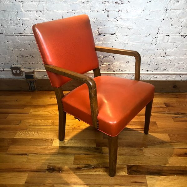 Pictured, Pumpkin vinyl Armchair, among the vintage rental furniture available from Catalyst Ranch