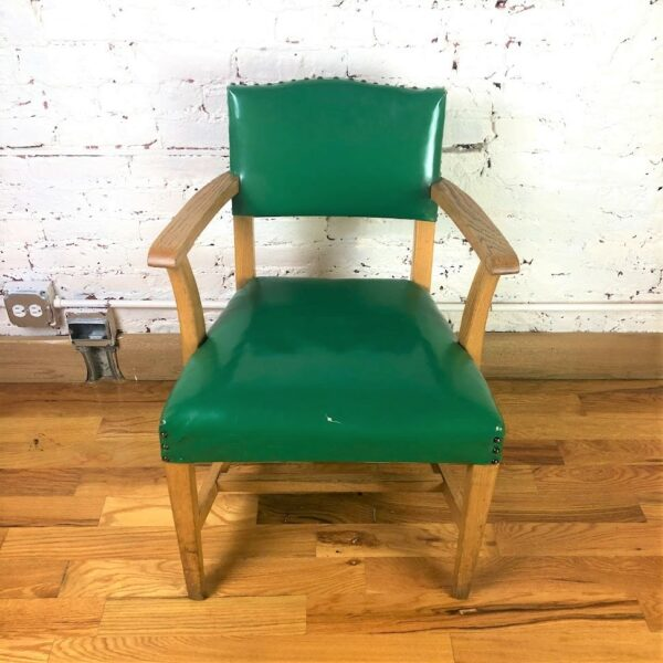 Pictured, Glossy Green Studded Armchair, among the vintage rental furniture available from Catalyst Ranch