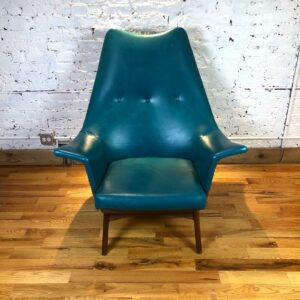 Pictured, Opulent Teal Vinyl Statement Armchair. With matching ottoman among the vintage rental furniture available from Catalyst Ranch