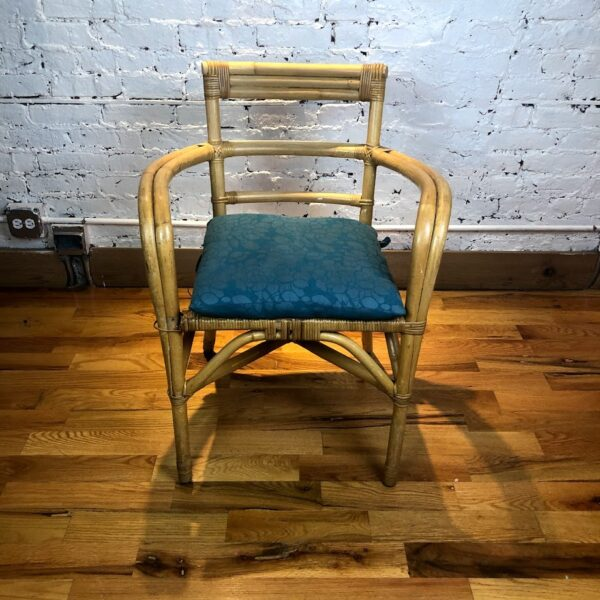 Pictured, Bamboo Armchair with Cornflower blue Fabric, among the vintage rental furniture available from Catalyst Ranch