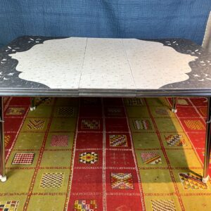Pictured, Formica Table with Fleur de Lis Motif, among the vintage rental furniture available from Catalyst Ranch