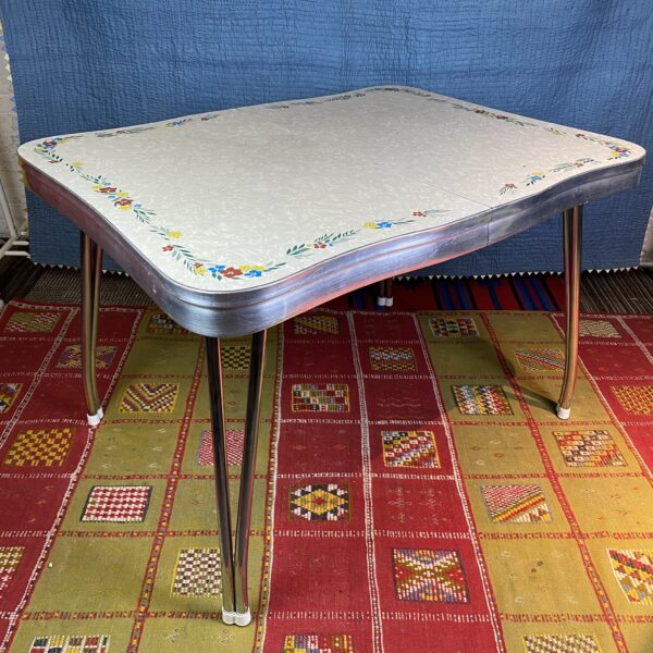 Pictured, Formica Table with Colorful Mini Garland Detail, among the vintage rental furniture available from Catalyst Ranch