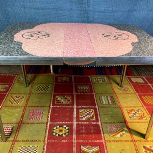 Pictured, Carnation Pink and Gray Formica Table, among the vintage rental furniture available from Catalyst Ranch