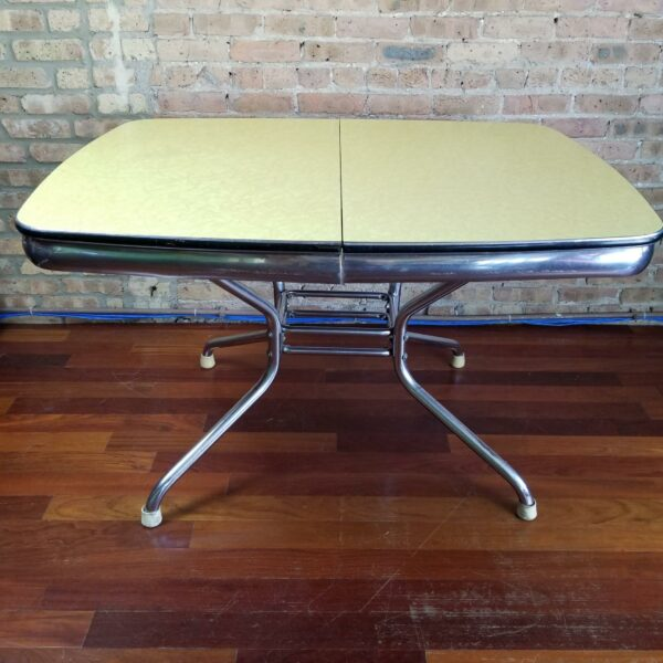 Pictured, yellow Formica dining table, among the vintage rental furniture from Catalyst Ranch