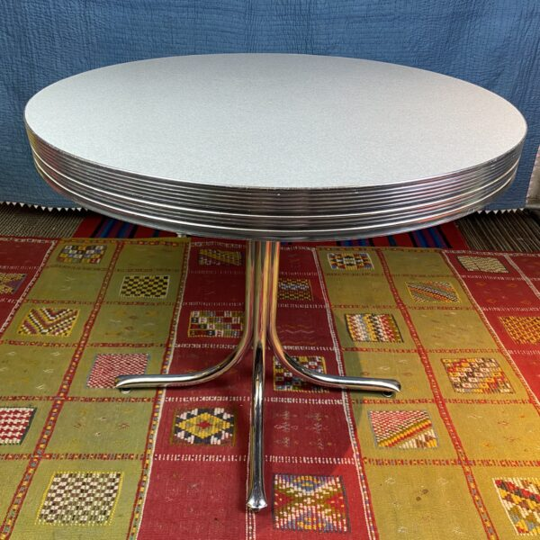 Pictured, Round Light Gray Formica Table, among the vintage rental furniture available from Catalyst Ranch
