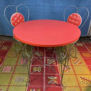 Pictured, Red Sweetheart Soda Shoppe Table and matching cushions and metal heart framed back Chairs, among the vintage rental furniture available from Catalyst Ranch