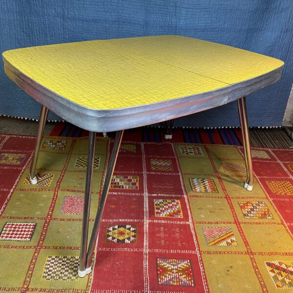Pictured, Yellow Formica Dining Table with minute detailing, among the vintage rental furniture available from Catalyst Ranch