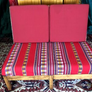 Pictured, Red Pattern-Stripe Two-Seater couch, among the vintage rental furniture from Catalyst Ranch