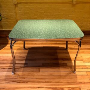 Pictured, Sage Green Formica Dining Table, among the vintage rental furniture from Catalyst Ranch