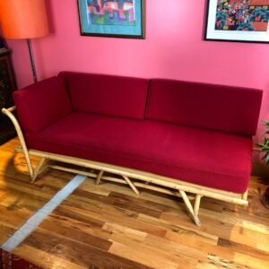 Pictured, Bamboo Single-Arm Red Cushion Couch with Backless Frame, among the vintage rental furniture from Catalyst Ranch