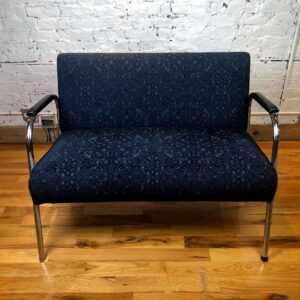 Pictured, Midnight Blue Scroll Pattern Two-Seater couch, among the vintage rental furniture from Catalyst Ranch